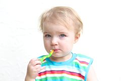 Portrait of baby eating porridge with spoon Royalty Free Stock Images