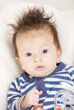 Portrait of baby with funny hair Royalty Free Stock Photo