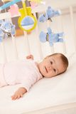 Portrait of baby girl in bed Royalty Free Stock Image