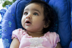 Portrait of a Baby Girl Gazing Up Stock Photo
