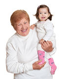 Portrait of baby girl and grandmother on white, happy family concept Stock Photo