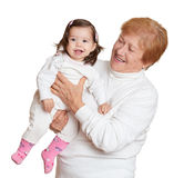 Portrait of baby girl and grandmother on white, happy family concept Stock Photography