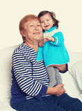 Portrait of baby girl and grandmother on white, happy family concept Royalty Free Stock Photo