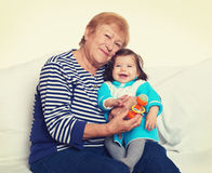 Portrait of baby girl and grandmother on white, happy family concept Royalty Free Stock Photos