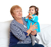 Portrait of baby girl and grandmother on white, happy family concept Stock Images