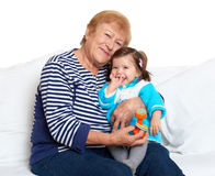 Portrait of baby girl and grandmother on white, happy family concept Royalty Free Stock Photography