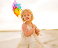 Portrait of baby girl holding colorful windmill Royalty Free Stock Images