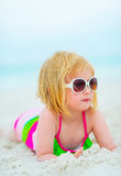 Portrait of baby girl laying on beach Royalty Free Stock Photography