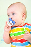 Portrait of baby girl with pacifier. Stock Photography