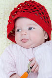 Portrait baby girl in red cap Royalty Free Stock Photography