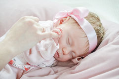 Sleeping baby holding parent hand close up Royalty Free Stock Photography