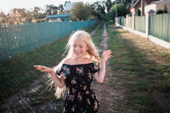 Portrait of a baby girl spinning in a field in sunset light Royalty Free Stock Photos