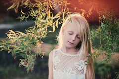Portrait of a baby girl in the sunset light on the nature Royalty Free Stock Photography