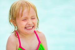 Portrait of baby girl in swimming pool. Portrait of baby girl in bikini in swimming pool stock image