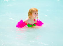 Portrait of baby girl swimming in sea Stock Photos