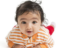 Portrait of a Baby Girl on White Background. Portrait of a Baby Girl lying on her tummy on a White Background royalty free stock photo