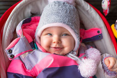 Portrait of baby girl in winter jacket Royalty Free Stock Image