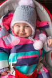 Portrait of baby girl in winter jacket Royalty Free Stock Photo