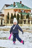 Cheerful girl on a walk on a winter day royalty free stock photo