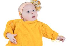 Portrait of  baby girl with yellow flower Royalty Free Stock Image