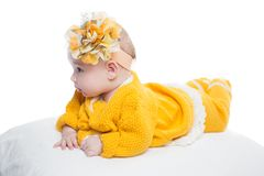 Portrait of  baby girl with yellow flower Stock Image