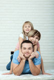 Portrait of baby and her parents lying on carpet in living room Royalty Free Stock Photography