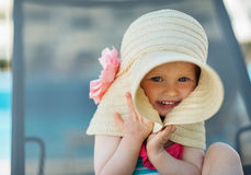 Portrait of baby hiding in big hat Stock Image