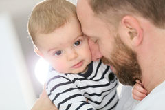 Portrait of the baby with his father. Portrait of daddy embracing baby boy Royalty Free Stock Images