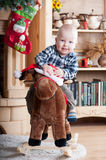 Portrait of Baby on horse (toy) little boy Stock Images