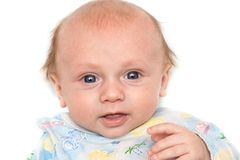 Portrait of a baby with interest Royalty Free Stock Image