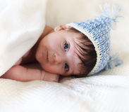 Portrait of a baby in knitting hat Stock Photos