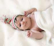 Portrait of a baby in knitting hat Royalty Free Stock Photos
