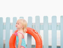 Portrait of baby with lifebuoy Stock Photos