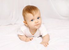Portrait of baby lying on the bed at home Royalty Free Stock Images