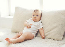 Portrait of baby lying at home Stock Image