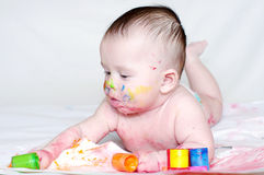 Portrait of baby with multi-colored paints. Portrait of four-months baby with multi-colored paints Royalty Free Stock Photo