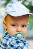 Portrait of baby with pacifier Royalty Free Stock Photos