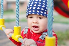 Portrait of baby on playground Stock Photo