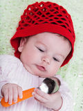 Portrait baby in red bonnet Royalty Free Stock Images
