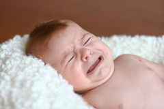 Portrait of baby's crying face Royalty Free Stock Photography