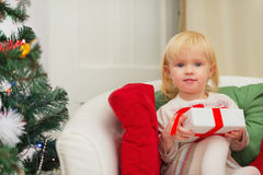 Portrait of baby sitting on chair with Christmas  Royalty Free Stock Photos