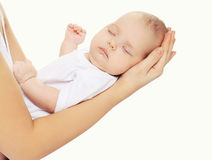 Portrait of baby sleeping on hands mother Royalty Free Stock Image