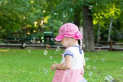 Portrait of a baby and soap bubbles royalty free stock photography
