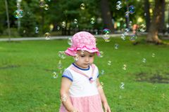 Portrait of a baby and soap bubbles royalty free stock image