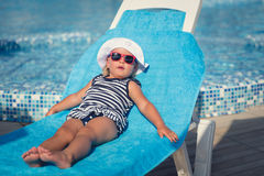 Portrait of baby on sunbed Royalty Free Stock Image