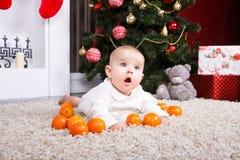 Portrait of baby with tangerine Stock Photo