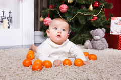 Portrait of baby with tangerine Stock Image