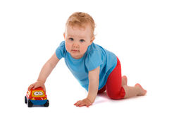 Portrait of baby with toy car Royalty Free Stock Images