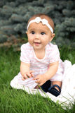 Portrait of baby wearing dress and bow Stock Photos