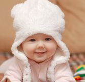 Portrait of babygirl in white hat. Portrait of beautiful funny baby  girl Royalty Free Stock Image